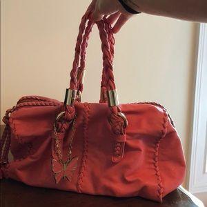 Bebe handbag, pinkish orange color